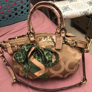Used coach handbag with bow.
